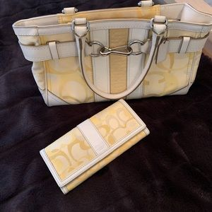 Coach matching  purse and wallet.